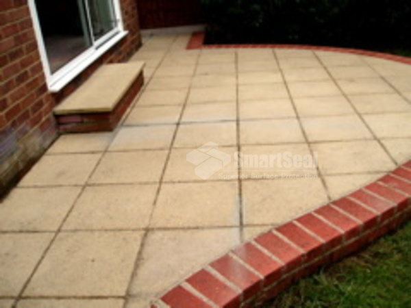 Patio after weed removal and jet washing